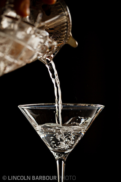 Martini being poured into a martini glass