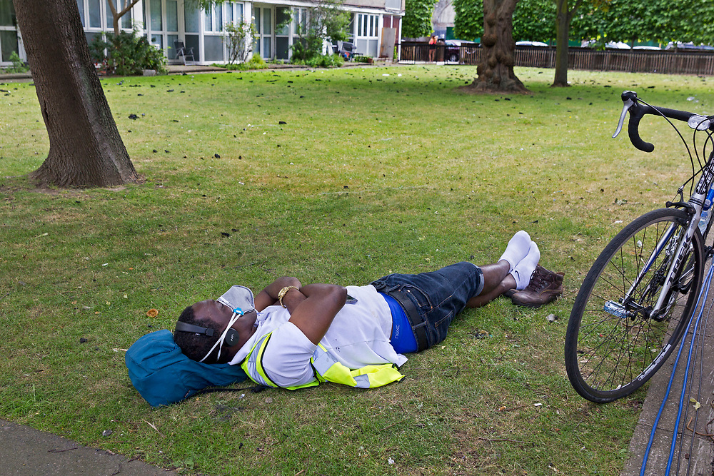 14 June 2017 taken between the hours of 12.22 - 14.49<br /> <br /> Resting amongst the burnt debris on the ground from the fire that engulfed the 24-storey tower block. <br /> <br /> The Grenfell Tower fire occurred on 14 June 2017 at the 24-storey, 220-foot-high (67 m), Grenfell Tower block of public housing flats in North Kensington, Royal Borough of Kensington and Chelsea, West London. It caused at least 80 deaths and over 70 injuries. A definitive death toll is not expected until at least 2018. As of 5 July 2017, 21 victims had been formally identified by the Metropolitan Police. Authorities were unable to trace any surviving occupants of 23 of the flats.<br /> <br /> Emergency services received the first report of the fire at 00:54 local time. It burned for about 60 hours until finally extinguished. More than 200 firefighters and 45 fire engines from stations all over London were involved in efforts to control the fire. Many firefighters continued to fight pockets of fire on the higher floors after most of the rest of the building had been gutted. Residents of surrounding buildings were evacuated due to concerns that the tower could collapse, but the building was later determined to be structurally sound.<br /> <br /> The tower contained 129 flats. Police were unable to trace any survivors from 23 of these, and their occupants are believed to have died in the fire. Firefighters rescued 65 people. Seventy-four people were confirmed to be in six hospitals across London, and 17 of them were in a critical condition. The fire started in a fridge-freezer on the fourth floor. The growth of the fire is believed to have been accelerated by the building's exterior cladding.  ( Source Wikipedia}