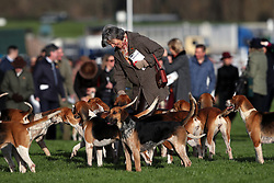 A racegoers with hounds during day one of the November Meeting at Cheltenham Racecourse, Cheltenham