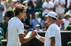 LONDON, July 3, 2018  Alexander Zverev (L) of Germany shakes hands with James Duckworth of Australia after the men's singles first round match at the Championship Wimbledon 2018 in London, Britain, on July 3, 2018. Alexander Zverev won 3-0. (Credit Image: © Tang Shi/Xinhua via ZUMA Wire)