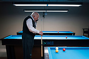 Bob Keller takes a call for his business, Keller Real Estate Group, at Three Cushion Billiards in Madison, WI on Friday, May 10, 2019.