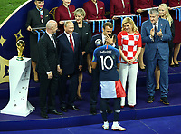 French President Emmanuel Macron on the stage with Fifa President Giovanni Infantino, Russian Federation President Vladimir Putin and Croatia President Olinda Grabar-Kitarovic congratulating Kylian Mbappe (France)<br /> Celebration Victory France <br /> Moscow 15-07-2018 Football FIFA World Cup Russia  2018 Final / Finale <br /> France - Croatia / Francia - Croazia <br /> Foto Matteo Ciambelli/Insidefoto