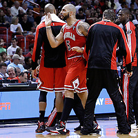 06 March 2011: Chicago Bulls power forward Carlos Boozer (5) celebrates with his teammates during the Chicago Bulls 87-86 victory over the Miami Heat at the AmericanAirlines Arena, Miami, Florida, USA.