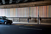 Public art underneath a railway bridge in Southwark, London. An artwork is also installed under the bridge consisting of a striped panel many metres long.