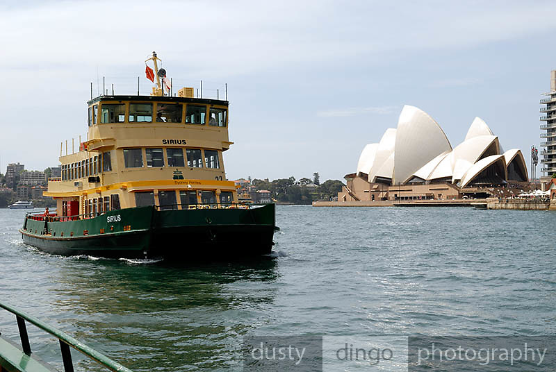 Sydney Harbour ferry with Sydney Opera House in background. Circular Quay, Sydney, Australia