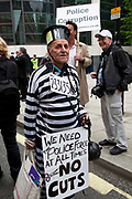 On a day when 400,000 public sector workers go on strike over cuts, pay and pensions, approximately 30,000 off duty police officers, marched in the capital wearing black caps to highlight projected job losses over the next four years. London, UK.