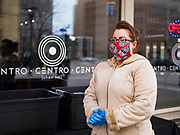 15 APRIL 2020 - DES MOINES, IOWA: CANDICE DEAL waits to hand free meals to people at Centro, a restaurant in Des Moines. The owners of Centro handed out 250 pasta meal Wednesday to give back to the hospitality workers in Des Moines. All of the restaurants in Des Moines are closed to sit down service and many that stayed open for take out service have closed as the shutdown has dragged on. Most non-essential businesses in Iowa are closed until 30 April. Because of business closings caused by the Novel Coronavirus (SARS-CoV-2) pandemic, well over 100,000 Iowans filed first time claims for unemployment in the last three weeks, more than applied during the peak of the Great Recession of 2008. Local food banks have seen an unprecedented spike in people seeking nutritional assistance.      PHOTO BY JACK KURTZ