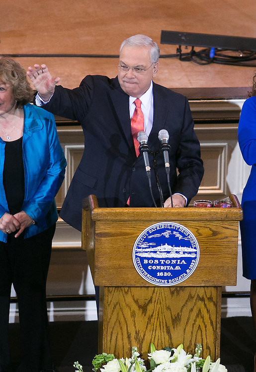 Boston, MA 03/28/2013<br /> Boston Mayor Thomas M. Menino waves as he takes the stage at Faneuil Hall on Thursday afternoon to announce that he will not seek re-election.