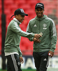 Manchester United's Jesse Lingard (left) and Marcus Rashford inspecting the pitch prior to kick-off