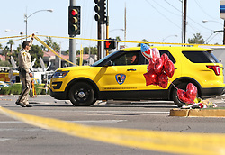 Oct 3, 2017 - Las Vegas, Nevada, U.S. - Authorities pass a police barricade close to a makeshift memorial on the Las Vegas Strip. A mass shooting occurred late Sunday evening nearby at a music festival. (Credit Image: © Ronda Churchill via ZUMA Wire)