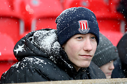A snow covered Stoke City fan in the stands