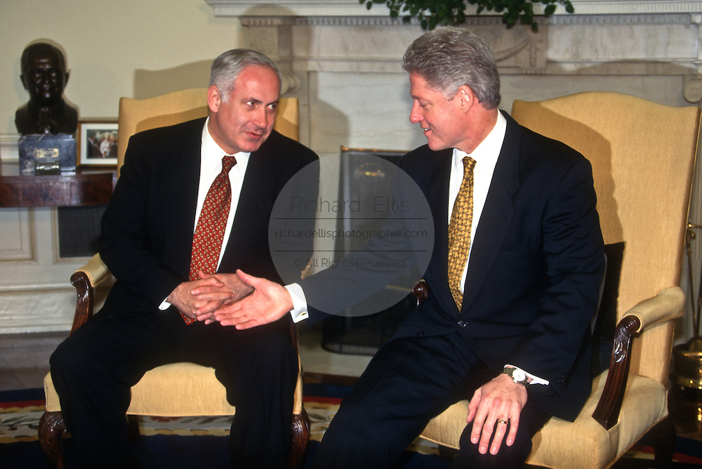 President Bill Clinton meets with Israeli Prime Minister Benjamin Netanyahu in the Oval Office of the White House April 7, 1997 in Washington, DC.