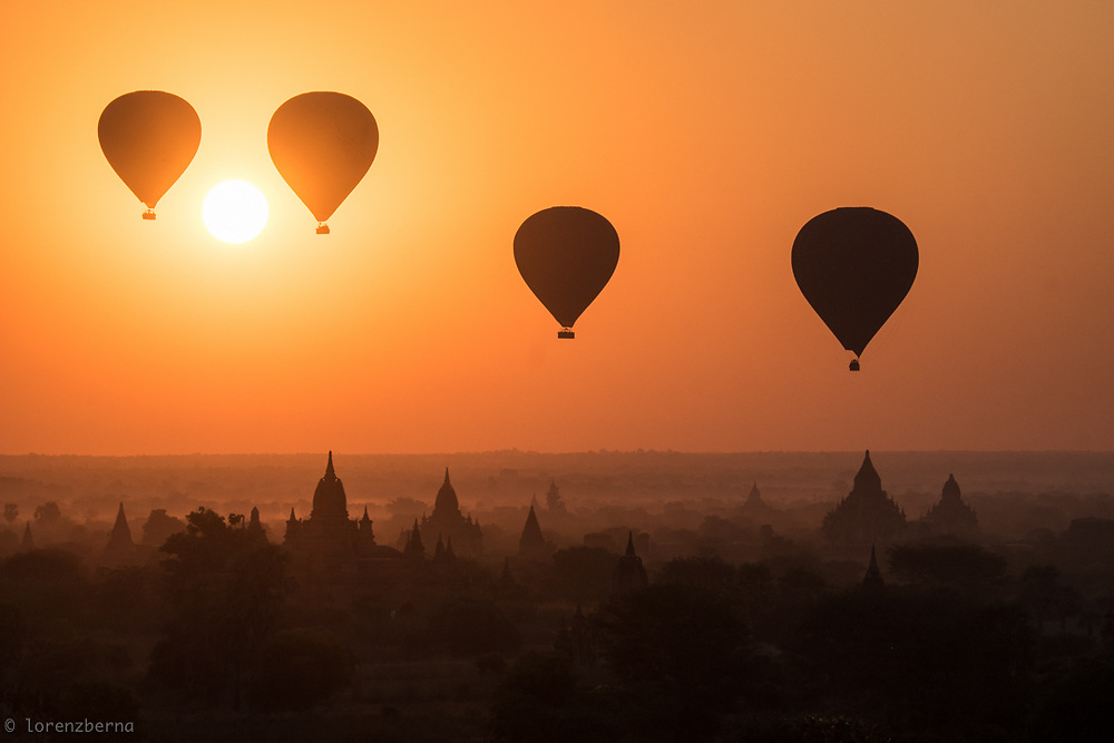The Hot air baloons rising over Bagan Temples area at sunrise are really an iconic and unforgettable view. The morning mist covering the ground, make the landscape look magical and surreal.<br /> Photo by Lorenz Berna