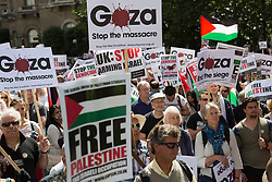 © Licensed to London News Pictures. 09/08/2014. London, UK. Protesters stage a national demonstration against Israeli military action in Gaza, marching from BBC Broadcasting House to Hyde Park, via Oxford Street and the US Embassy in central London on 9th August 2014. Photo credit : Vickie Flores/LNP