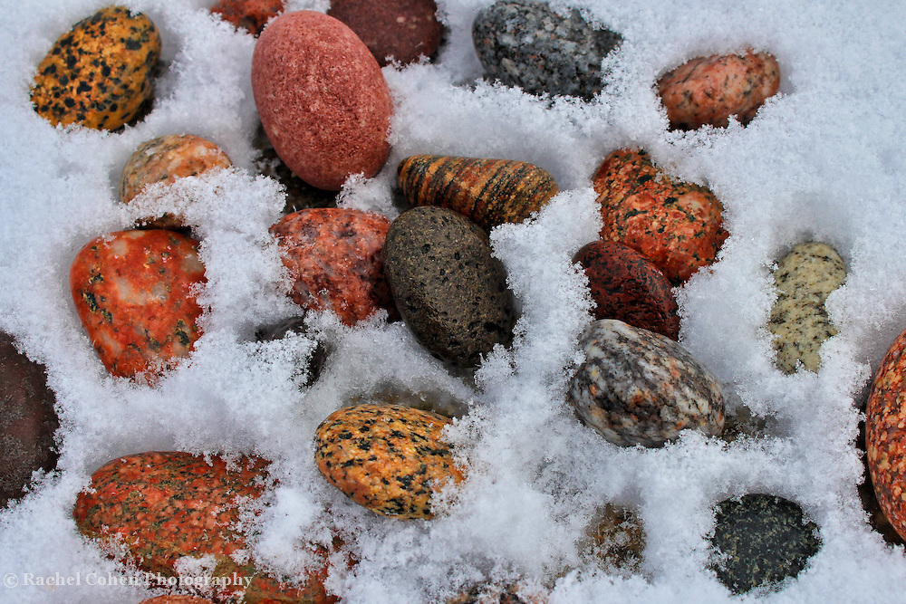 """""""Cold Stones""""<br /> <br /> Bold and beautiful stones of every color on Lake Superior's shore lie within ice and snow on a cold winters day!!<br /> <br /> Nature Abstracts by Rachel Cohen"""