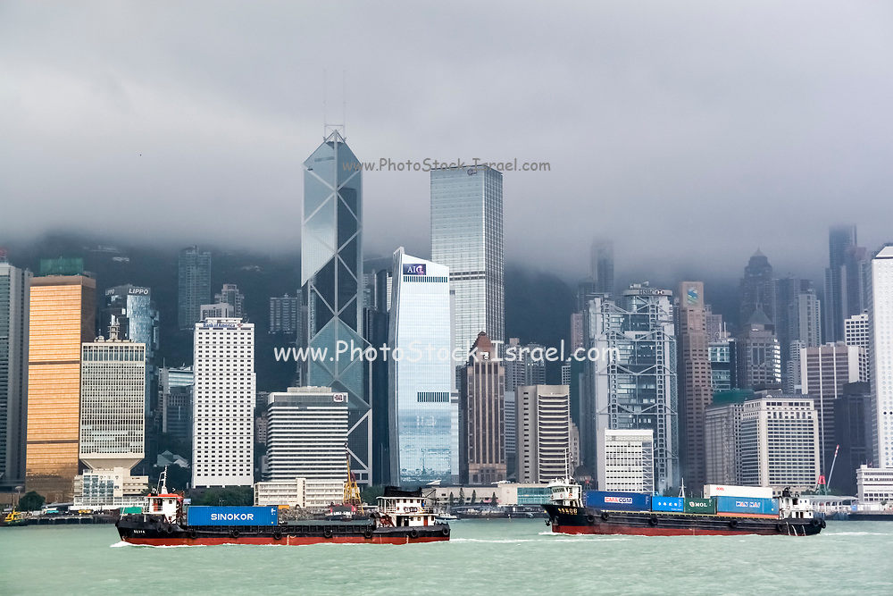 Asia, Southeast, People's Republic of China, Hong Kong. A view of the city from the ferry from Kowloon peninsula (Tsim Sha Tsui) to Hong Kong island.