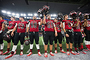 The Iraan High School wave to the fans after being defeated 49-28 by Bremond High School in the state championship game at AT&T Stadium in Arlington, Texas on December 15, 2016. (Cooper Neill for The New York Times)