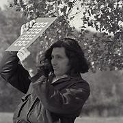 Steve Appleford scours a portfolio at the Eddie Adams Workshop, 1993.