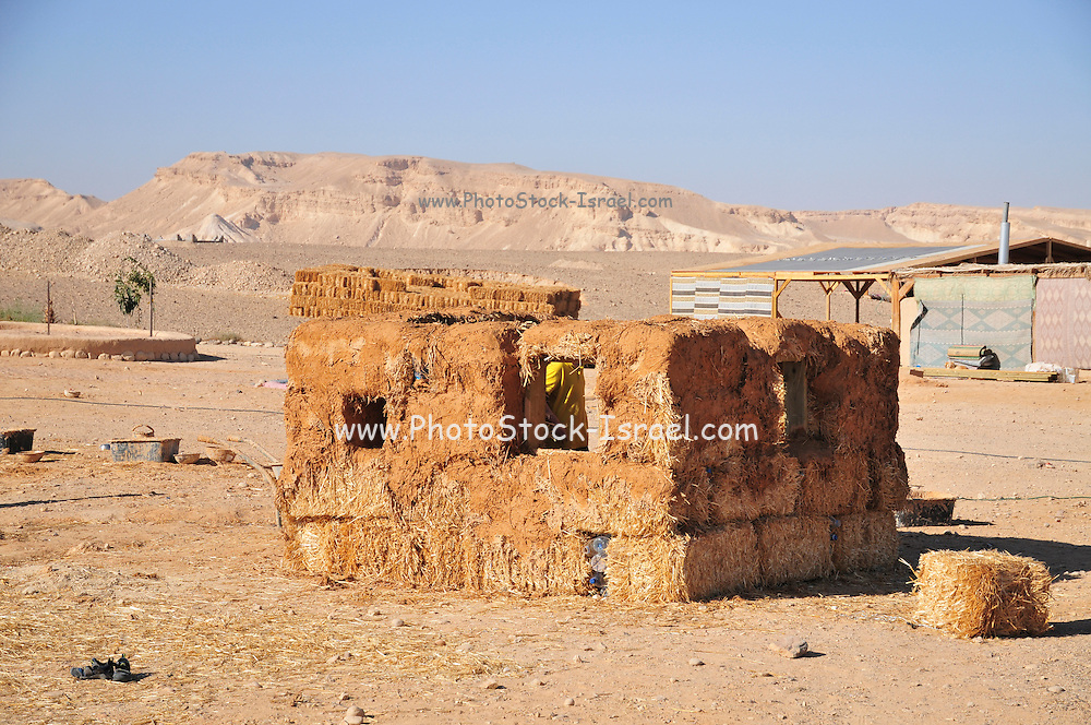 House constructed from mud and straw at the ecological village of Tzukim, Israel, Aravah, All construction material are environmental friendly such as wood and mud. waste water and garbage are reused for irrigation and compost
