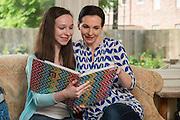 Stefani Lucas Eckman and her daughter, Alden Eckman, pose for a photograph, April 23, 2015.