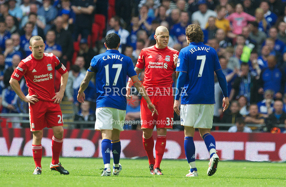 LONDON, ENGLAND - Saturday, April 14, 2012: Liverpool's Martin Skrtel clashes with Everton's Nikica Jelavic during the FA Cup Semi-Final match at Wembley. (Pic by David Rawcliffe/Propaganda)