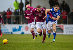 Arbroath's Jason Thomson and Queen of the South's Dan Pybus. Arbroath 2 v 0 Queen of the South, Scottish Championship game played 15/2/2020 at Arbroath's home ground, Gayfield Park.