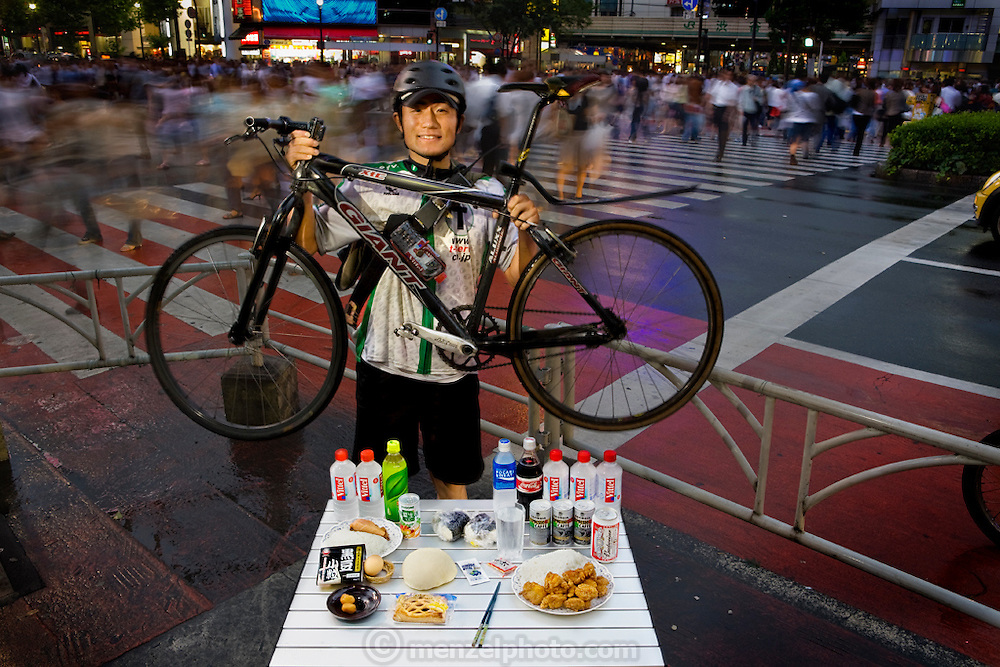 Jun Yajima, who works as a messenger at T-Serv Bike Messenger service, relaxes at his home in his tiny apartment with a beer and takeout food outside Tokyo, Japan after a long day at work. (Jun Yajima is featured in the book, What I Eat: Around the World in 80 Diets.) MODEL RELEASED.