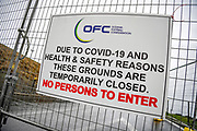 Locked gates and Covid-19 warning signs displayed at the OFC Football grounds in Stonefields, Auckland on the 27th May 2020 during Level 2 lockdown.<br /> Copyright photo: Andrew Cornaga / www.photosport.nz