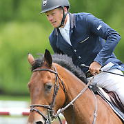 Filip De Wandel riding Gentley in action during the $35,000 Grand Prix of North Salem presented by Karina Brez Jewelry during the Old Salem Farm Spring Horse Show, North Salem, New York, USA. 15th May 2015. Photo Tim Clayton