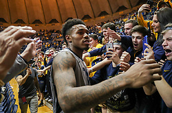 Feb 26, 2018; Morgantown, WV, USA; West Virginia Mountaineers guard Daxter Miles Jr. (4) celebrates with students after beating the Texas Tech Red Raiders at WVU Coliseum. Mandatory Credit: Ben Queen-USA TODAY Sports