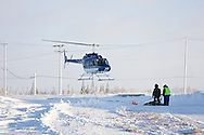 01874-11803 Polar Bear (Ursus maritimus) biologists preparing to airlift bear from Polar Bear Compound, Churchill MB