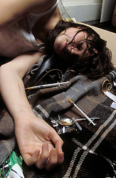 Heroin addict shooting up; UK. Posed by model
