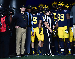 Michigan Wolverines head coach Jim Harbaugh waits along with his team to come onto the field prior to the the Chick-fil-A Bowl Game at  the Mercedes-Benz Stadium, Saturday, December 29, 2018, in Atlanta. ( Kyle Hess via Abell Images for Chick-fil-A Kickoff)