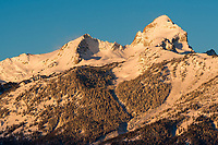 Buck Mountain in the Tetons glows in the early morning light as seen from the Glacier View turnout.