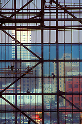 Stock photo of workmen on scaffolding and beams working on building frame during construction at Minute Maid Park (Enron Field at time of photograph)