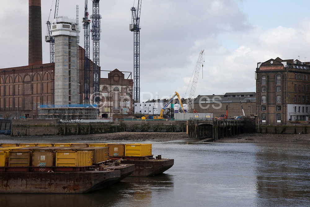 Redevelopment construction site surrounding Lots Road Power Station on 1st February 2020 in London, England, United Kingdom. Lots Road Power Station is a disused coal and later oil-fired and later gas-fired power station on the River Thames at Lots Road in Chelsea in the Royal Borough of Kensington and Chelsea, which supplied electricity to the London Underground system. It is sometimes erroneously referred to as Fulham Power Station, a name properly applied to another former station a mile upriver. The property company that now owns the site wishes to convert the station into shops, restaurants and apartments, and to construct additional buildings, including two skyscrapers, on the adjoining vacant land.