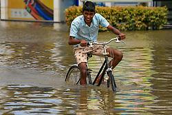 A Sri Lankan boy rides a bicycle across the flooded Southern Expressway at   Godagama, Matara, southern part of Sri Lanka. Tuesday 30 May 2017 (Photo by Tharaka Basnayaka/NurPhoto) *** Please Use Credit from Credit Field ***