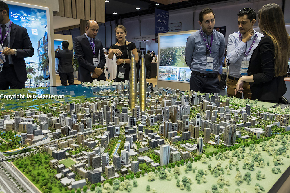 Model of new property development at  Dubai Creek Harbour by developer Emaar  at property trade fair in Dubai United Arab Emirates