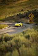 Image of a sports car drifting on a corner, road in Idaho, Porsche 911 T, model and property released