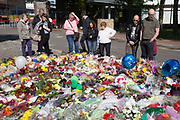 London, UK. Saturday 25th May 2013. A second memorial to Drummer Lee Rigby outside the entrance to the army barracks in Woolwich, London, UK. Flowers from every section of the local community along with messages of condolence and support. On the afternoon of 22 May 2013, Lee Rigby, a British Army soldier and a Drummer of the Royal Regiment of Fusiliers, was killed by two attackers near the Royal Artillery Barracks in Woolwich, south-east London.