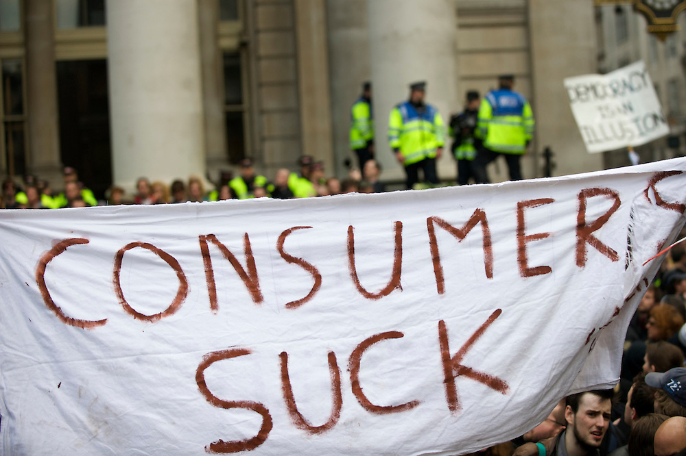 A large banner hangs above the thousands of anti-capitalism protesters congregated at the Bank of England on the first day of the G20 Summit, April 1, 2009.  Many were decked out in garb themed by the four horses of the apocalypse.  Police lined the streets in anticipation of violence.
