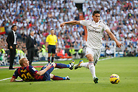 Real Madrid´s James (R) and Barcelona´s Mathieu (L) during La Liga match between Real Madrid and F.C. Barcelona in Santiago Bernabeu stadium in Madrid, Spain. October 25, 2014. (ALTERPHOTOS/Victor Blanco)
