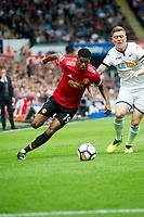 Football - 2017 / 2018 Premier League - Swansea City vs. Manchester United<br /> <br /> Marcus Rashford of Manchester United attacks  Alfie Mawson of Swansea City—<br /> , at Liberty Stadium.<br /> <br /> COLORSPORT/WINSTON BYNORTH