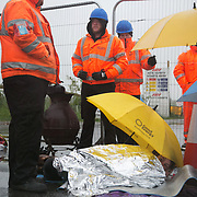 Day two of the Rolling Resistance, Preston New Road, Lancashire. Security violently try to prevent climate protectors to lock-on at the gates to Quadrilla drill site. Two activists managed to lock themselves down and block the gates. A lock-on, where two or more lock themselves together inside a re-inforced tube is used as a peaceful non-violent way of blocking the gates.to the site.The New Preston Road Quadrilla site is almost ready to start drilling for shale gas after many delays caused by local objections. Lancashire County council voted against fracking but the conservative central government forced it through.