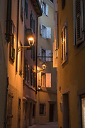View of city street at evening, Trieste, Italy.