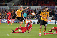 Newport county's Scott Boden has a shot at goal blocked by York city's Luke Summerfield. Skybet football league two match, Newport county v York city at Rodney Parade in Newport, South Wales on Saturday 5th Sept 2015.  pic by Andrew Orchard, Andrew Orchard sports photography.