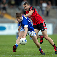 Cratloe's Cathal McInerney is tackled by Clondegad's Cormac Ryan