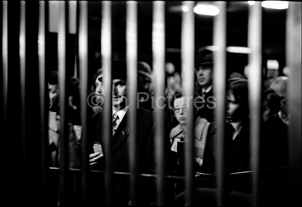 Exit in Holborn tube station 8.30am, crowded with commuters. Coming and Going is a project commissioned by the Museum of London for photographer Barry Lewis in 1976 to document the transport system as it is used by passengers and commuters using public transport by trains, tubes and buses in London, UK.