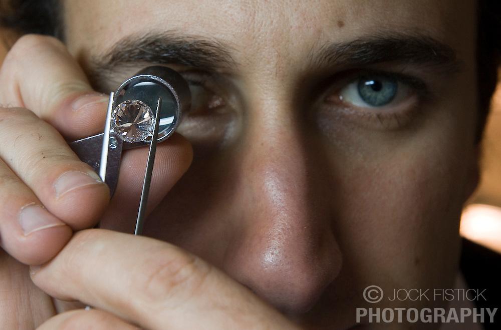 Arko Tourbendian, uses a loop to inspect a 5.9 karat diamond, at the Diamond Land store in Antwerp, Belgium, on Thursday, Oct. 22, 2009. (Photo © Jock Fistick)