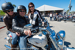 Claudine Poacher and Thierry Legendarme of Paris, France get the lowdown from Harley-Davidson's Chris Kutsch before starting out on their test ride of a 2014 Softail Deluxe during Daytona Bike Week. , FL., USA. March 8, 2014.  Photography ©2014 Michael Lichter.